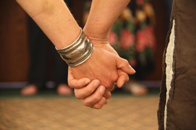 UNPAC - holding hands